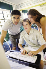 Three teens working on a computer